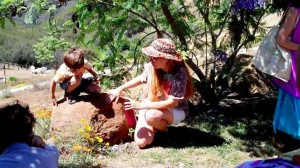 herbalist Julie James working with children out in the field