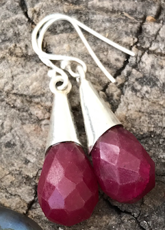 pair of earrings featuring the July birthstone